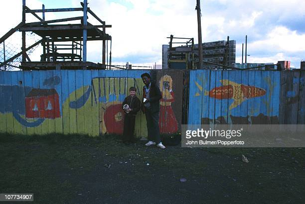 Two boys stand outside an adventure playground in Manchester England in 1976