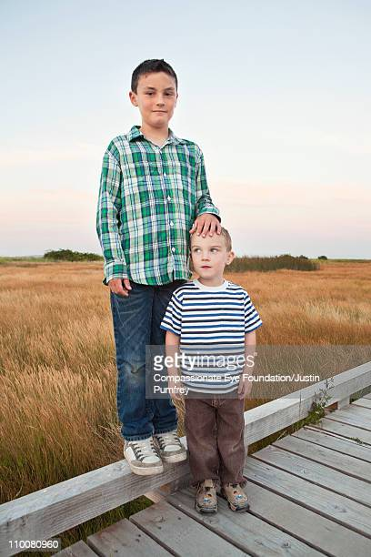 Two boys standing together on a walkway