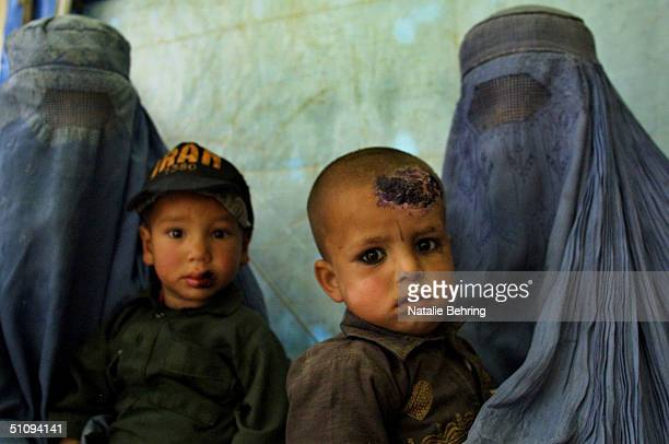 Two Boys Suffering From Cutaneous Leishmaniasis, A Disfiguring And Disabling Skin Disease, Wait For Treatment At A Clinic May 8, 2002 In Kabul,...
