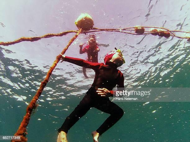Two boys swimming underwater