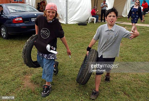Two boys take away souvenirs from the motorbike display at the Boost Mobile V8 International car racing at Pukekohe Raceway on sunday