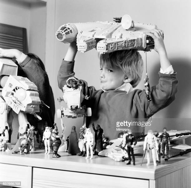 Two boys, Thomas and Robbin playing with their Star Wars toys. 16th November 1983.