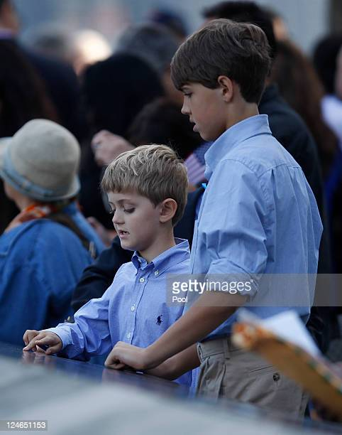 Two boys touch the names of lost loved ones during tenth anniversary ceremonies of the September 11 2001 terrorist attacks at the World Trade Center...