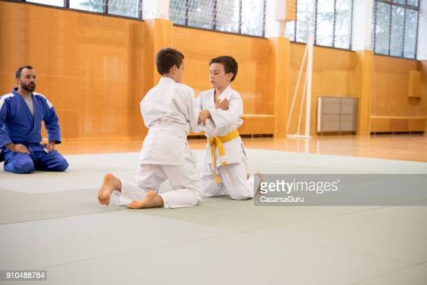 two boys training a judo fighting - judo stock photos and pictures