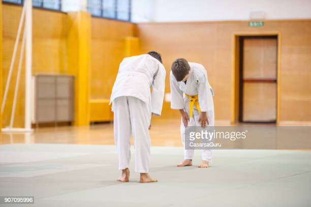 two boys training judo fight - respect stock pictures, royalty-free photos & images