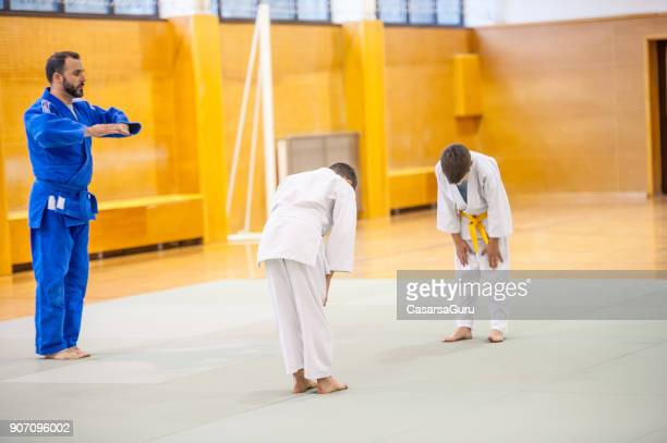 two boys training judo fight - showing respect stock pictures, royalty-free photos & images