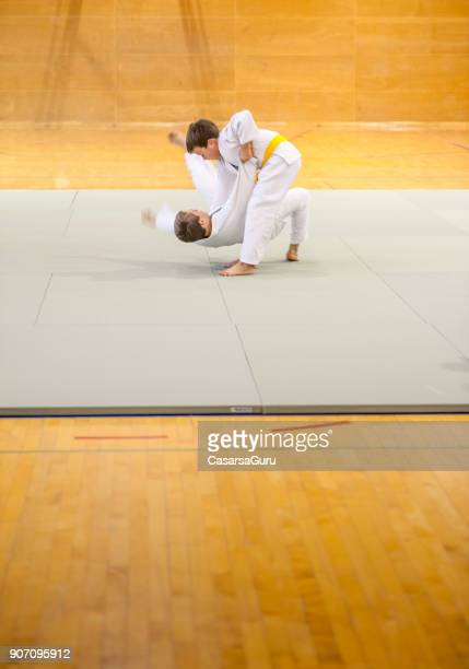 two boys training judo - judo stock photos and pictures