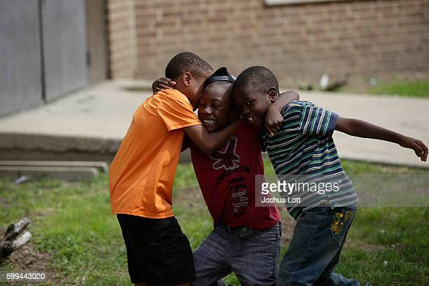 Two boys try to wrestle Brysten Edwards to the ground at the West Calumet Housing Complex on September 4 2016 in East Chicago Indiana The soil at the...