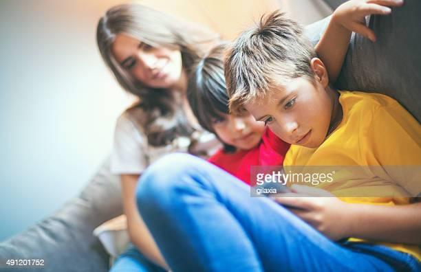 Two boys using digital tablet.