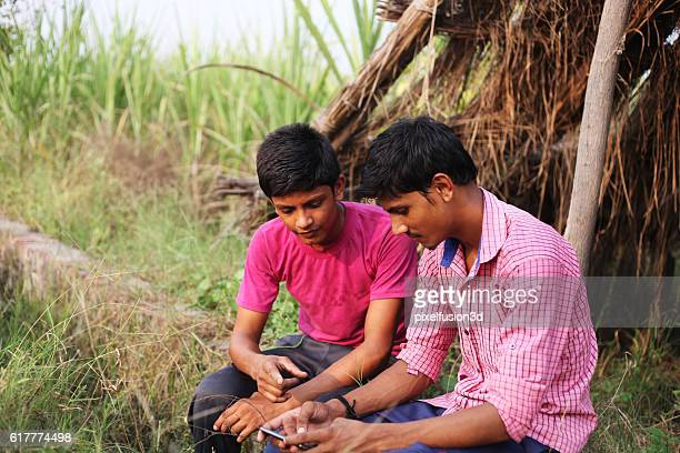 Two boys using Smartphone and text messaging
