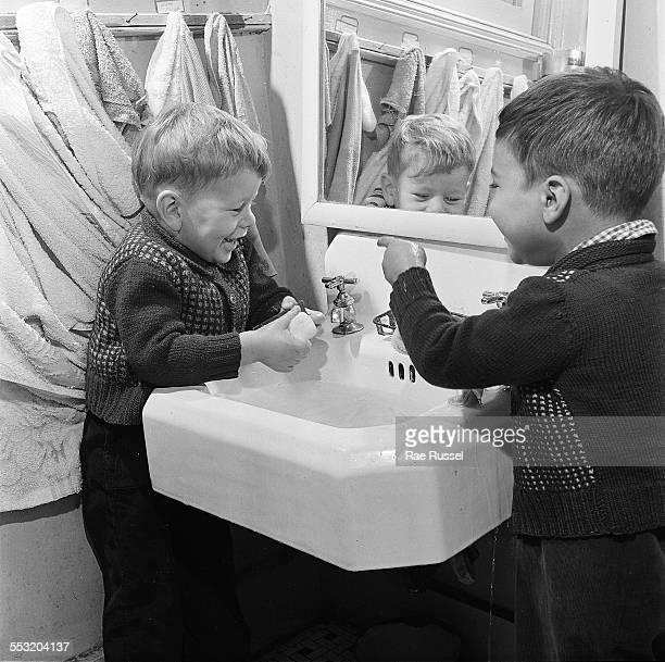 Two boys wash their hands at a day nursery Brooklyn New York New York 1946