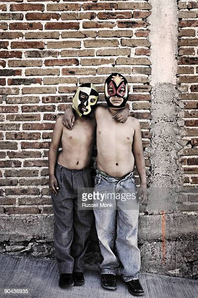 Two boys wearing Mexican  wrestling masks