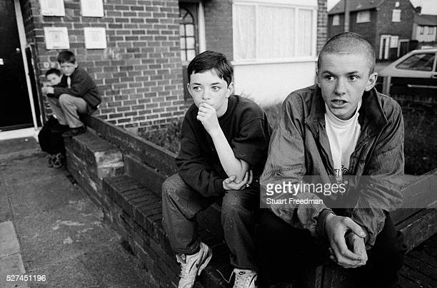 Two boys while away their day on the Northwood Estate Kirkby, Merseyside a notoriously run down inner city area where crime and unemployment are high...