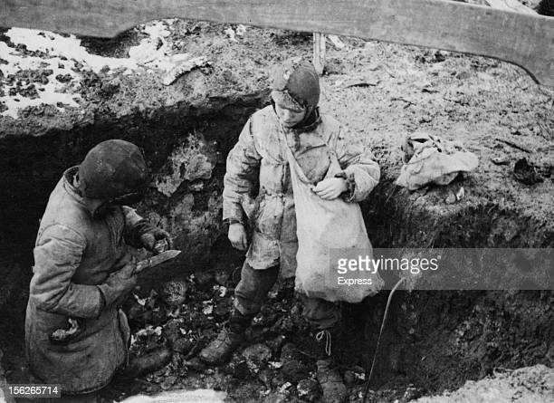 Two boys with a cache of potatoes they have found during the manmade Holodomor famine in the Ukraine former Soviet Union Spring 1934 The food had...