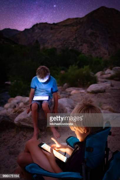two boys zoned out on digital screen - digital native stock pictures, royalty-free photos & images