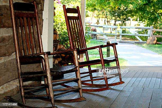 two brass rocking chairs on a patio - rocking chair stock pictures, royalty-free photos & images