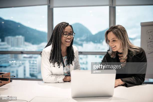 two brazilian businesswoman in office in rio de janeiro - efficiency stock pictures, royalty-free photos & images