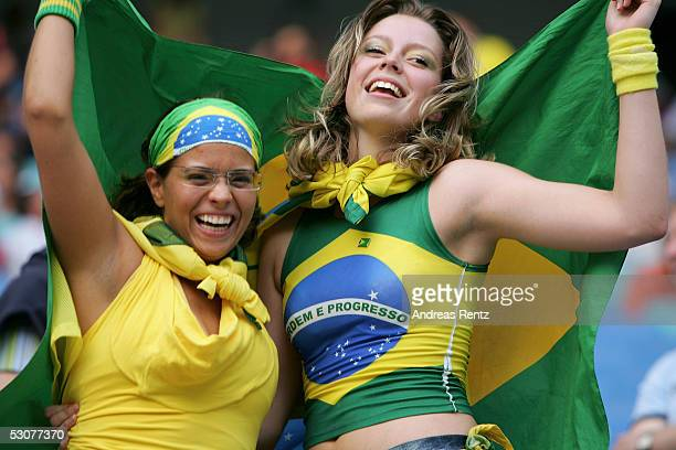 Two Brazilian fans wave their national flag before the FIFA Confederations Cup 2005 match between Brazil and Greece on June 16 2005 in Leipzig Germany