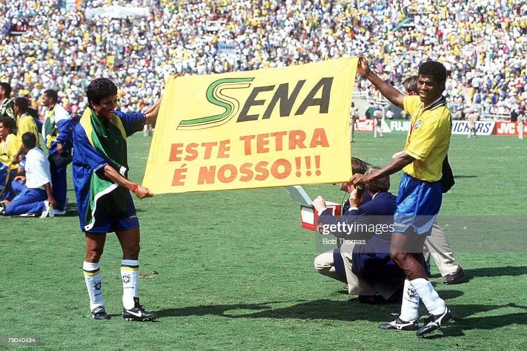 Two Brazilian players hold up a tribute to Formula One racing driver Ayrton Senna, who was killed in a crash in May 1994, at the 1994 FIFA World Cup final in the Rose Bowl in Pasadena, California, USA on 17th July 1994. Brazil would go on to win the match against Italy 3-2 on penalties after extra time.