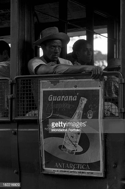 Two Brazilians seated together at the top of a tram Rio de Janeiro 1958