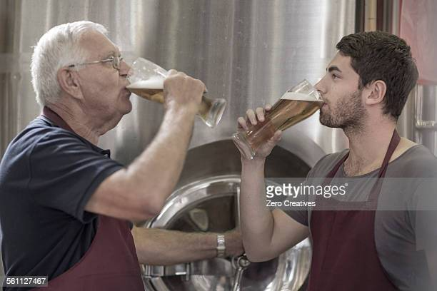 Two brewers drinking beer in the brewery
