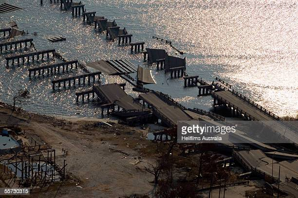 Two bridges lay in ruins after being destroyed by Hurricane Katrina September 11 2005 near Biloxi and Ocean Springs Mississippi Katrina devastated...