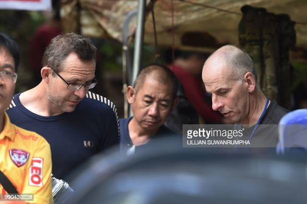 Two British divers John Volanthen and Richard William Stanton are seen with Thai rescue personnel at the Tham Luang cave area at Khun Nam Nang Non...