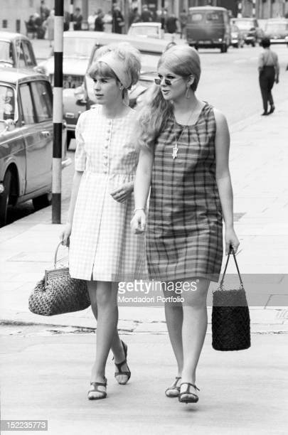 Two British girls in minidress walking in the street London 1960s