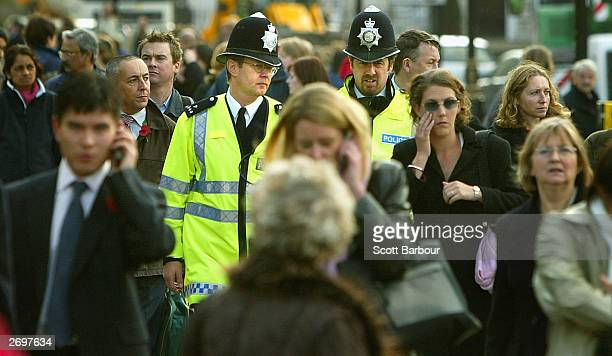 Two British police officers patrol the streets November 4 2003 in London England Plans released today will make police forces in England and Wales...