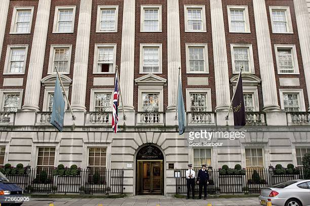 Two British police officers stand outside of the Millennium Hotel in Grosvenor Square on November 28, 2006 in London, England. Detectives are...