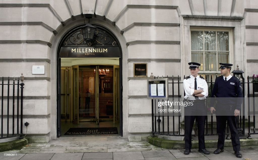 Two British police officers stand outside of the Millennium Hotel in Grosvenor Square on November 28, 2006 in London, England. Detectives are continuing to examine five locations in London where traces of polonium-210 were found after Former Russian spy, Alexander Litvinenko's death. Litvinenko's death has been linked to the presence of a 'major dose' of radioactive polonium 210 in his body.