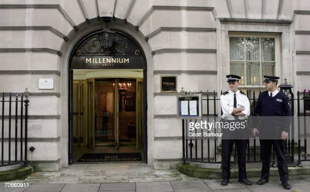 Two British police officers stand outside of the Millennium Hotel in Grosvenor Square on November 28 2006 in London England Detectives are continuing...
