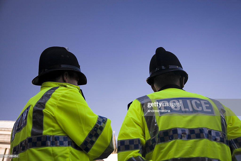 Two British Policemen wearing Traditional Helmets-Click below for more. : Stock Photo
