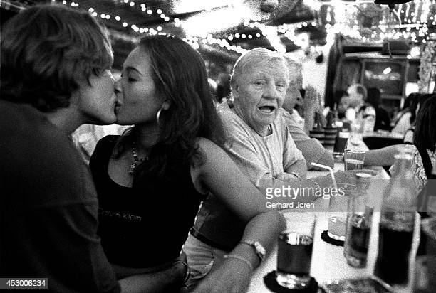 Two British sex tourists relax at a bar on Second Road in Pattaya During the high season as many as 30000 prostitutes work in the coastal resort city...