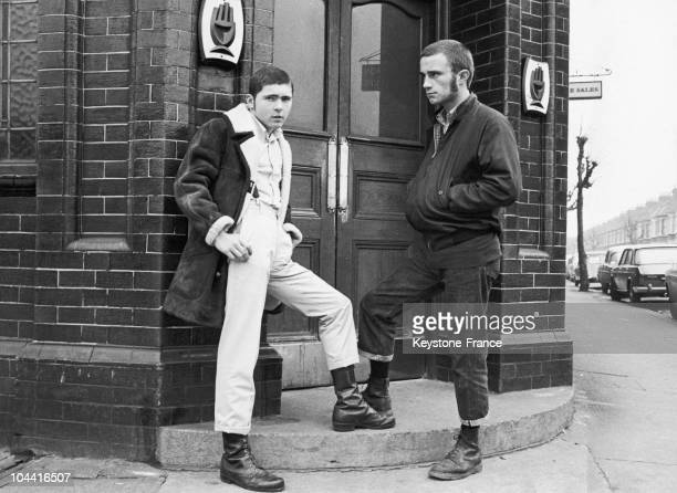 Two British SKINHEADS wearing their usual shoes before their locale in London in 1970