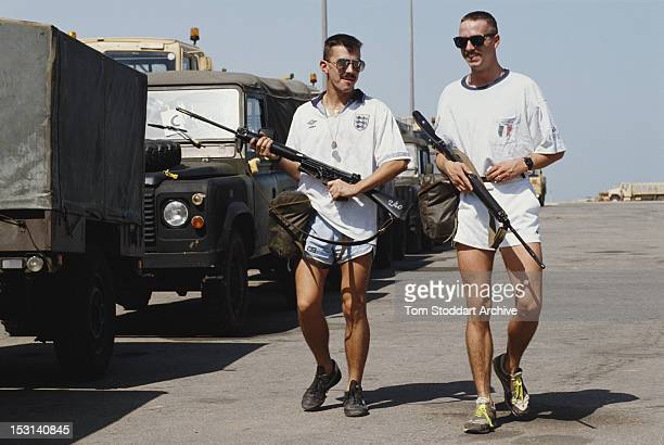 Two British soldiers of the 7th Armoured Brigade patrolling in football shirts after their arrival in Saudi Arabia during the Gulf War 1990