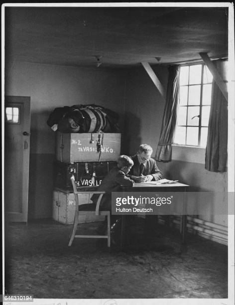 Two British subjects expelled from Egypt during the Suez Crisis in their temporary home at Eaves Brow Hall The hall has been set up as a refugee...