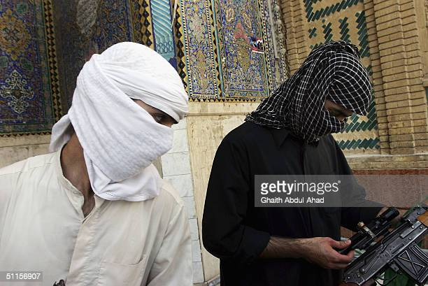 Two British volunteers stand outside the Imam Ali shrine on August 10 2004 in the holy city of Najaf Iraq They came from Britain on Monday to fight a...