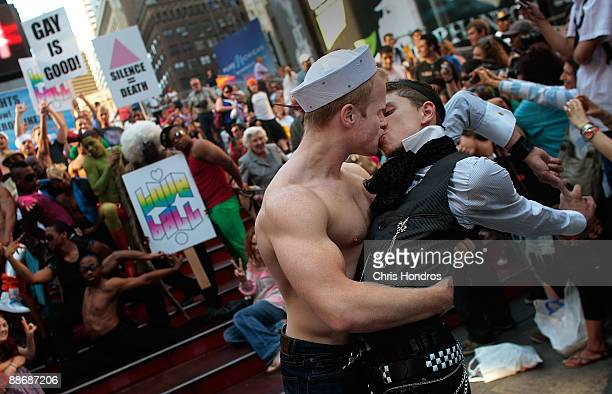 Two Broadway dancers re-create the a famous image of a soldier kissing a nurse at the end of WWII in a Times Square gathering to celebrate the 40th...