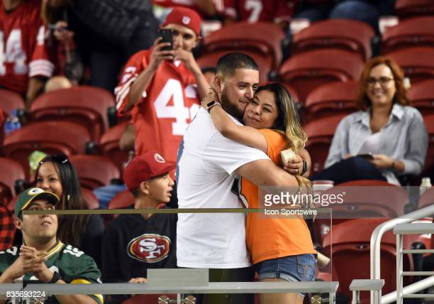 Two Broncos fans get engaged after a marriage proposal during an NFL preseason game between the Denver Broncos and the San Francisco 49ers on August...