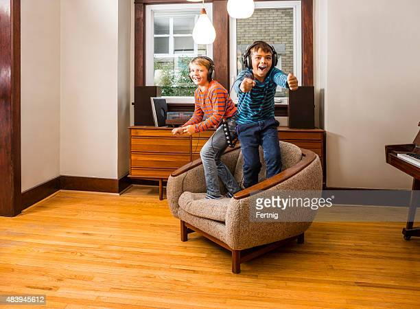 Two brother rocking out at home