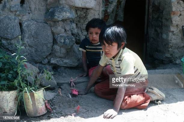 Two brothers alone in their home play outside their house September 4 1982 in Santa Catarina Mexico Poverty is prevalent in Santa Catarina