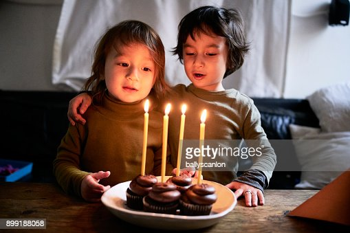 Two Brothers Celebrating A Birthday