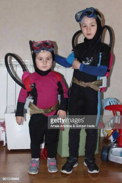 two brothers dressed as divers - diving beetle stock pictures, royalty-free photos & images