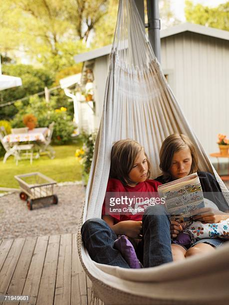 Two brothers in a hammock.