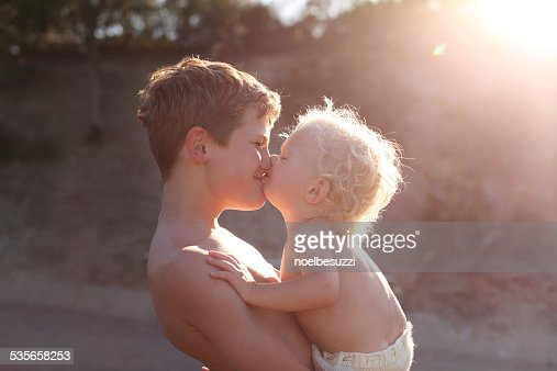 Two brothers kissing