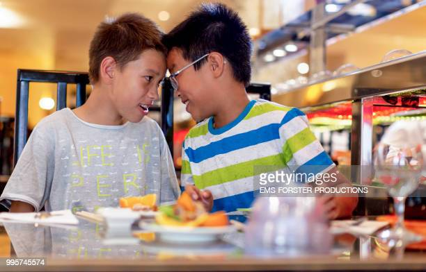 two brothers of different fathers in asian restaurant head to head