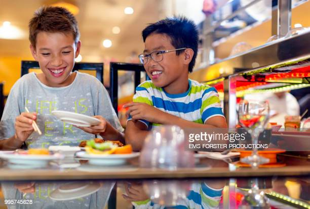 two brothers of different fathers in asian restaurant