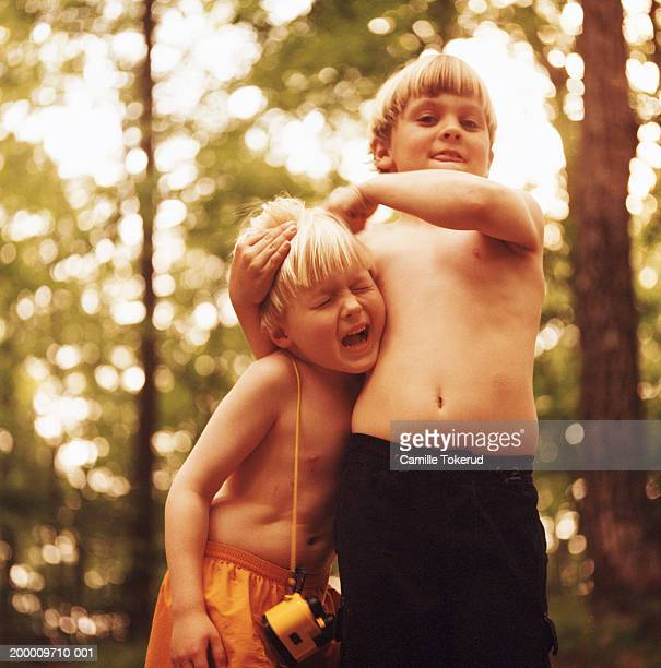 Two brothers (5-9) playing outdoors