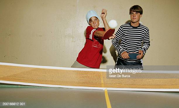 Two  brothers (12-15) playing table tennis